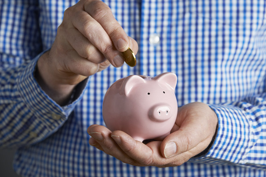 Save business money in piggy bank