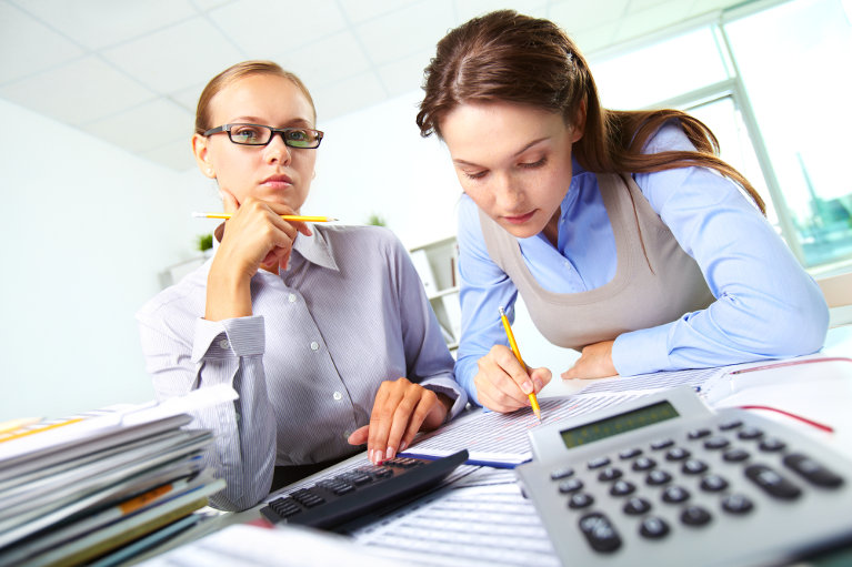 Accountants working on business financial numbers